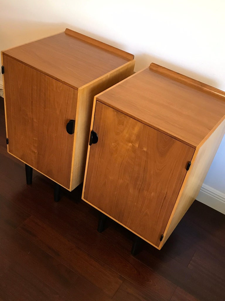 Very rare nightstands or cabinets by Finn Juhl for Baker. These are two-tone with walnut tops and fronts, and birch sides. Each nightstand is accompanied by two drawers and a shelf, which are interchangeable. Very good condition. One cabinet has a