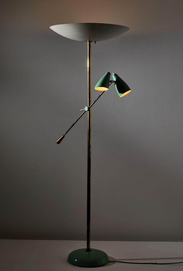 Rare floor lamp by Stilnovo. Manufactured in Italy, circa 1940s. All original enameled metal and patinated brass. Arm and shades adjust to various positions. Rewired with brown cloth cord. Five sockets E27 25w maximum bulbs and three E27 60w maximum
