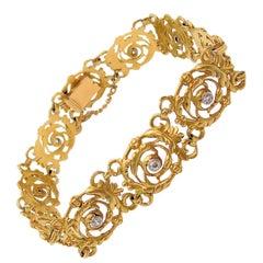Rare French 18 Karat Yellow Gold and Platinum Rococo Style Diamond Bracelet