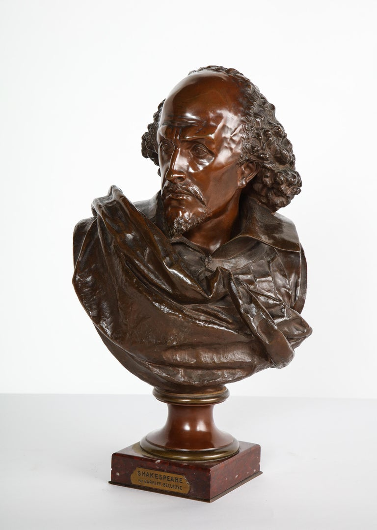 Rare French bronze bust of William Shakespeare by Carrier Belleuse and Pinedo, circa 1870.  Signed - A. Carrier-Belleuse Paris and inscribed PINEDO fondeur, on a red marble base.  Measures: 22