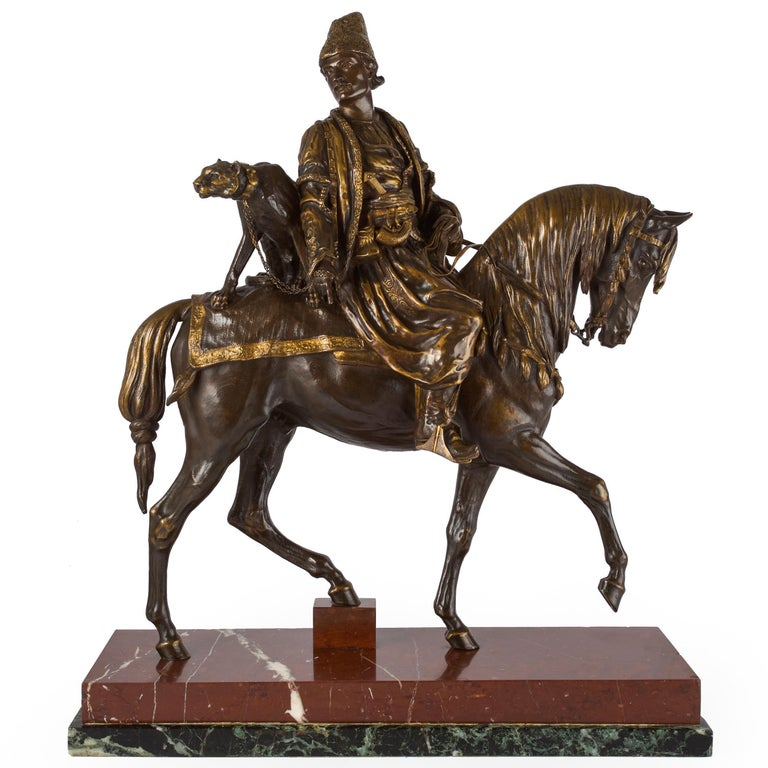A very fine and quite rare model of Un Chasseur Persan au Guépard, conceived in 1878 and exhibited at the Paris Salon in 1879; it was for this group that Dubucand was awarded the rare honor of a Gold Medal. It is a very infrequent find on the open