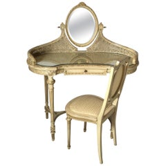 Rare French Crème Painted Hand Carved Wood and Cane Vanity with Chair