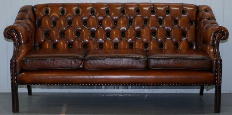 We are delighted to offer for sale this rare vintage circa 1960s Chesterfield fully restored Cigar brown leather club sofa   I work with Luxury Chesterfield sofas and armchairs and have done for years, to find one with long elegant turned legs