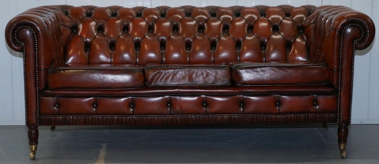 We are delighted to offer for sale this rare vintage circa 1960s Chesterfield fully restored Cigar brown leather club sofa 