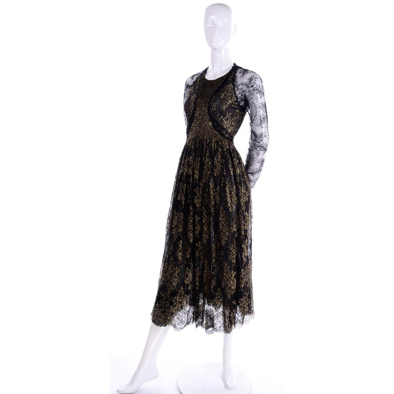This is an outstanding early 1990's vintage Geoffrey Beene sheer black and gold metallic lace dress with a layered lace skirt. This rare dress is in a gorgeous black lace woven with gold metallic flowers, and the hemline is scalloped. This dress is