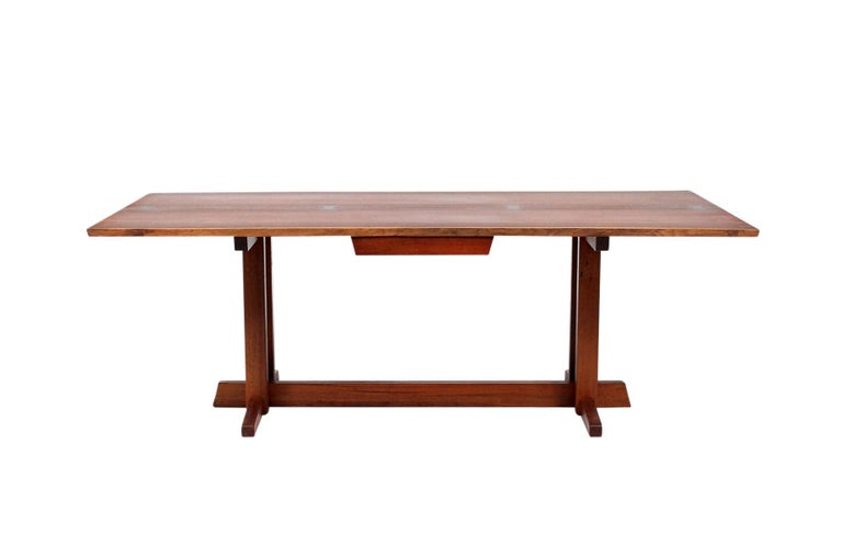 Extremely rare Nakashima Frenchman's cove desk in walnut with four rosewood butterfly's. Desk was executed for Mr. Wallace a partner at the law firm Coopers & Lybrand and interior by Paul Planert Design of Pittsburgh PA.  Desk with full