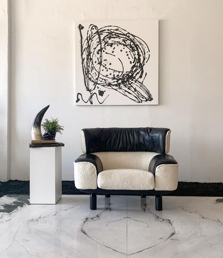 This Gianfranco Frattini Cassina Bull lounge chair is absolutely stunning. This piece was designed back in 1987 during the start of the Postmodern / Memphis Milano movement. This chair was and still is a piece of trendsetting design to this