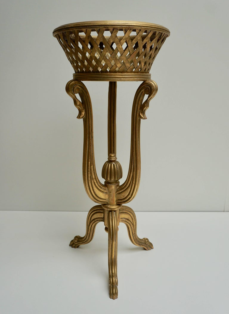 A rare and elegant tripod giltwood flower basket in the Art Deco style of Edgar Brandt, circa 1930.