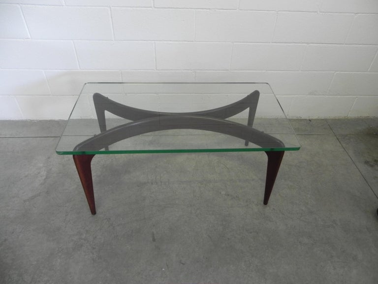 A rare documented Gio Ponti mahogany coffee table documented in ESSEMPI by Roberto Aloi. Original 25 mm crystal glass top by Fontana Arte.