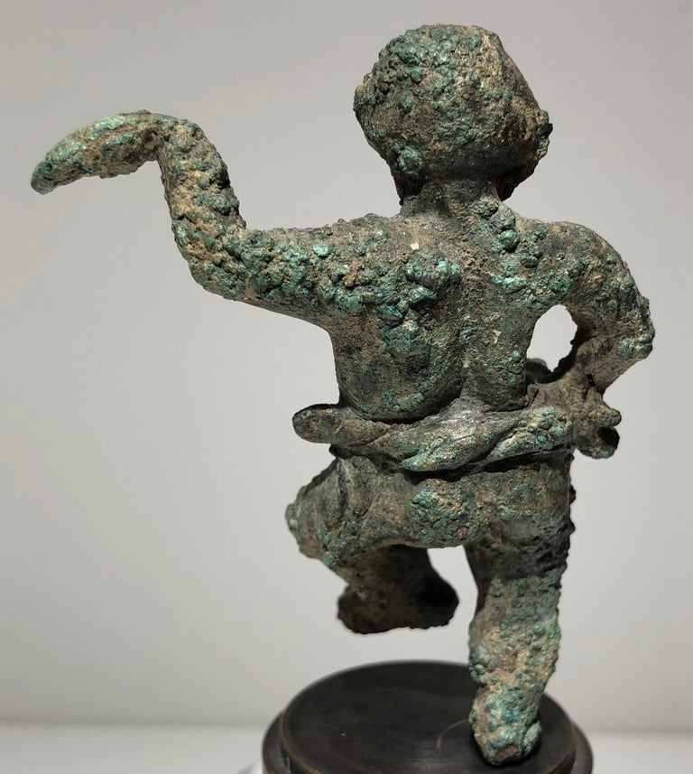 Rare Greek bronze grotesque statuette of a pugilist boxer. Alexandrian, Hellenistic Period, 1st century BC. Provenance: Ex. Collection Louis-Gabriel Bellon (1819-1899). Formerly in the collection of Julien Gréau, Lot 985. Published: Collection
