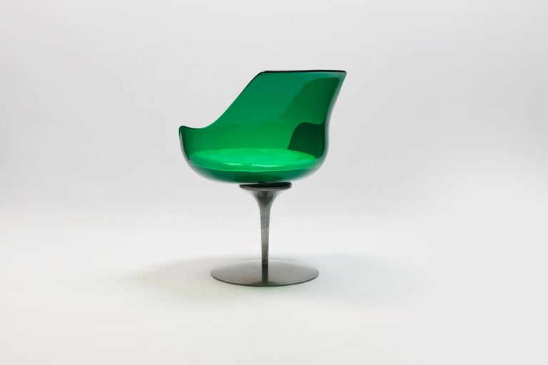 Magnificent very rare green colour edition 'Champagne' chair by American designer couple Estelle and Erwin Laverne. Organic shaped lucite shell with a white buttoned vinyl seat cushion on sprung auto return revolving aluminium base.  Designed in