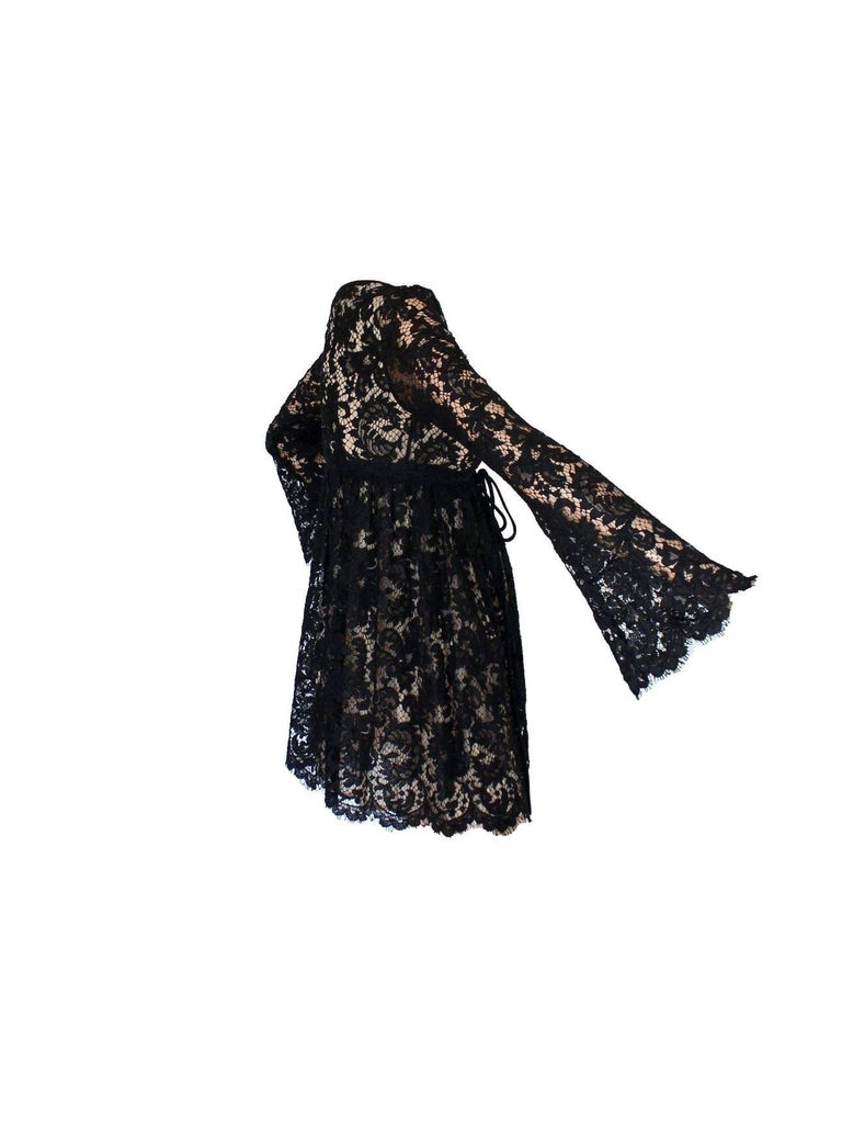 Stunning Gucci by Tom Ford lace dress From his SS 1996 collection for Gucci Finest black lace Fully lined with nude silk  Made in Italy Dry Clean Only Size 38  Seen in the AD campaign and on the runway show for season reference only
