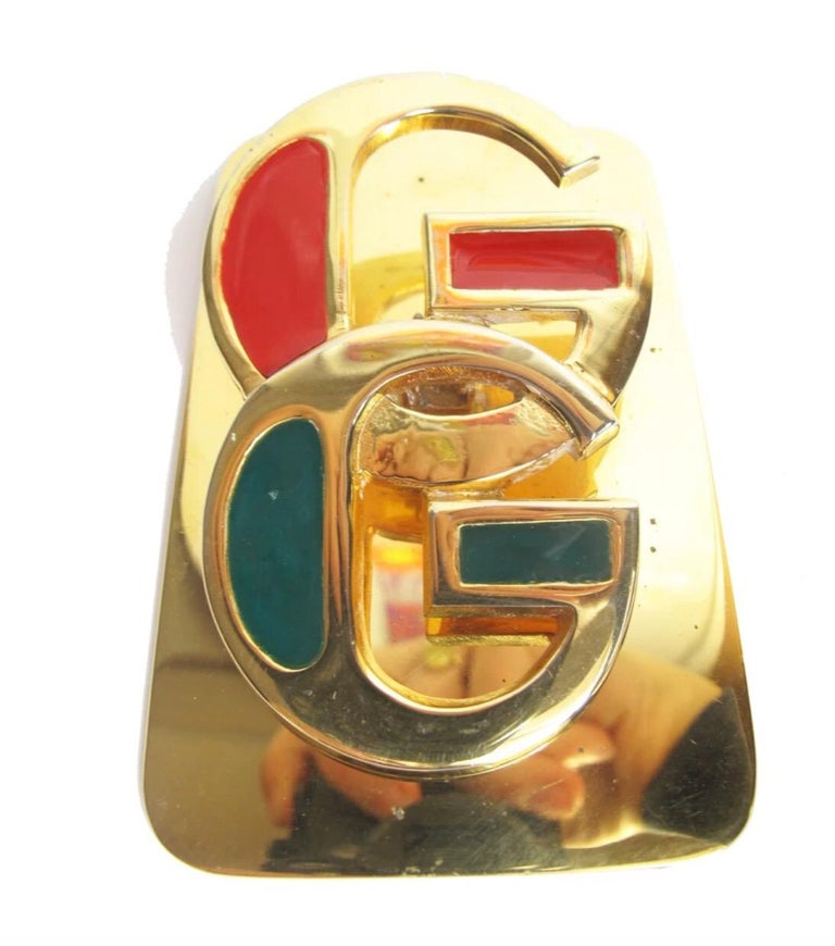 """1970s Gucci brass and enamel paper clip desk accessory. Condition: good, all over wear and tarnish. Stamped Gucci . 4"""" x 3.5"""""""