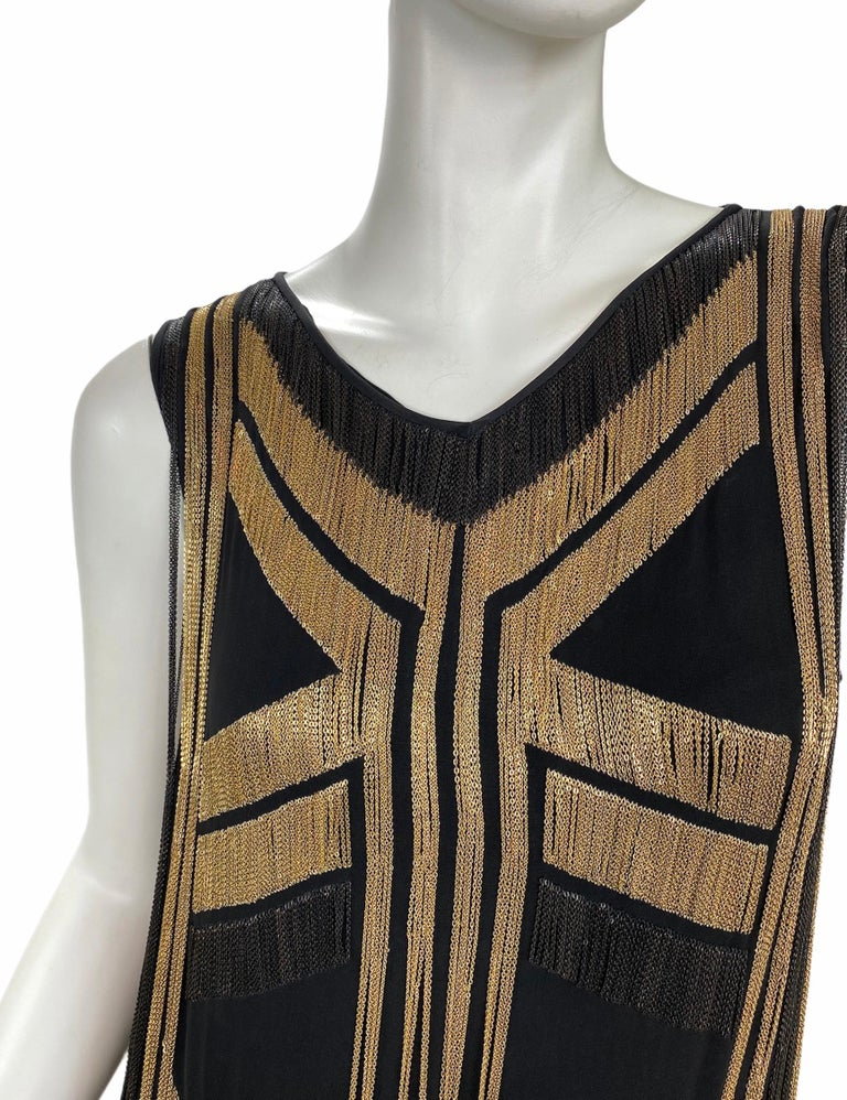 Rare Gucci Fringed chain-embellished silk-georgette dress   Gucci glamorously re-imagines the Roaring Twenties with this flapper-inspired silk-georgette dress. Covered in delicate yet tough-talking gold and black chains, this captivating runway
