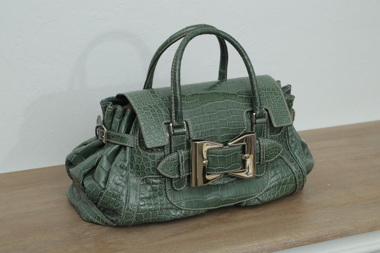 Limited edition Queen green crocodile bag.  This a gorgeous crocodile travel bag with dual handles with a 4