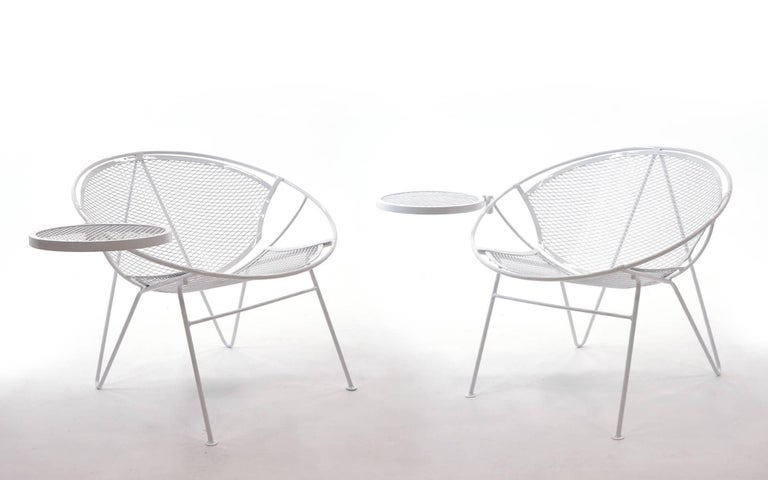 We have eight of these sets. A set consists of a chair, detachable footrest, and side table. This design is the best combination of style and comfort in outdoor seating. Very rare hairpin leg version of the the Maurizio Tempistini design John
