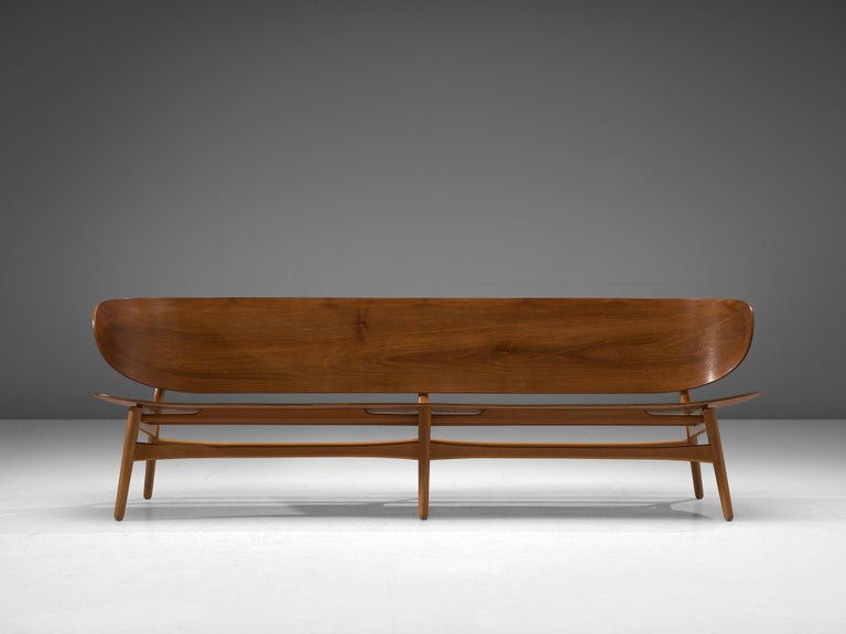 Hans J. Wegner for Fritz Hansen, FH 1935/4 bench, walnut and beech, Denmark, design 1948, manufactured circa 1950  This rare and largest version ever made of the FH 1935 bench with sofa appeal by Hans J. Wegner. This piece is one of the results of