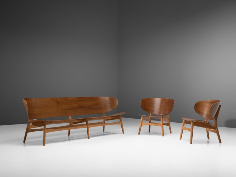 Hans J. Wegner for Fritz Hansen, FH 1935-1934 sofa bench and two 'FH 1936' lounge chairs, walnut and beech, Denmark, design 1948, manufactured, circa 1950.  This living room set consists of two 'FH 1936' lounge chairs a rare and largest version