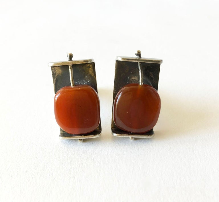 Rare, sterling silver cufflinks featuring natural carnelian flat beads on wire created by Henry Steig of New York City, circa 1950's. Cufflinks measure 7/8
