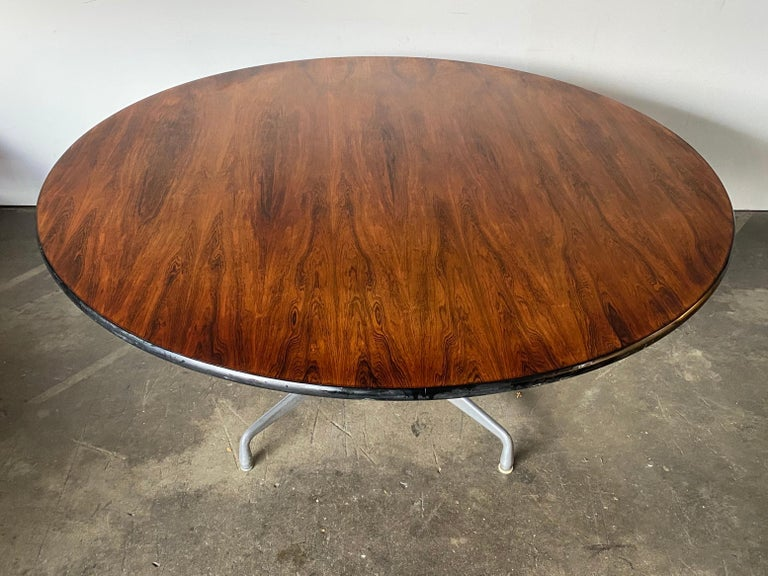 This is the biggest Eames rosewood table we have ever had. 60 inches in diameter, big enough for friends and family. Executed in stunning rosewood with bold coloring and vibrant figured grain pattern. Signed and guaranteed authentic. Tabletops