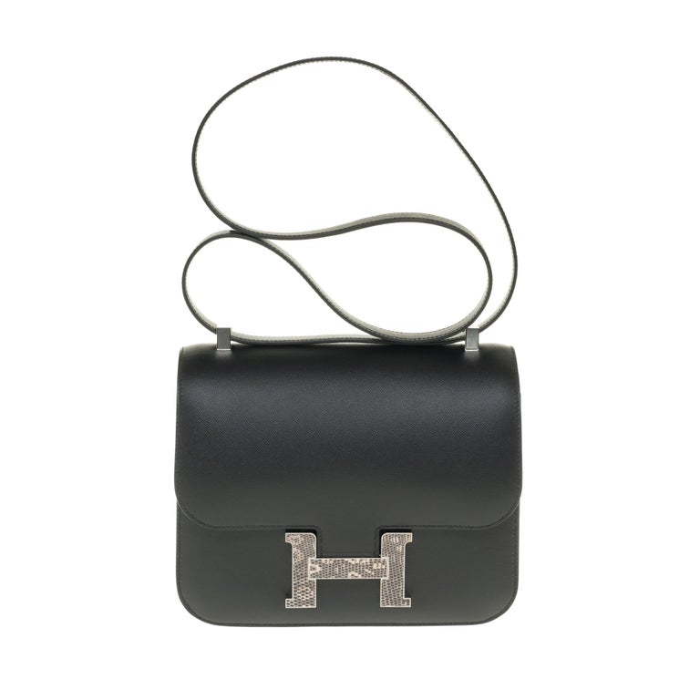 BRAND NEW / VERY RARE / FULL SET / CONSTANCE 24 IN BLACK MADAME CALF AND CLASP IN OMBRE LIZARD !  Exceptional and rare Hermes Constance handbag in black Madame calf leather with Ombre lizard clasp, palladium silver metal trim, transformable handle