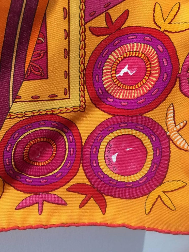 GORGEOUS Hermes Coupons Indiens silk scarf in excellent condition.  Limited edition silk screen design c2008 by Aline Honoré.  Unique abstract multi-pattern print in orange,  reds, pink, and golds.  100% silk, hand rolled hem.  Made in France.