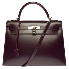 Rare Hermès Kelly 32 sellier handbag with strap in Purple calf box and SHW