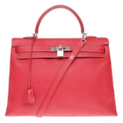 Rare Hermès Kelly 35 sellier shoulder bag in red togo leather, silver hardware