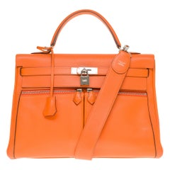 Rare Hermès Kelly Lakis 35 handbag with strap in orange swift calf leather, PHW