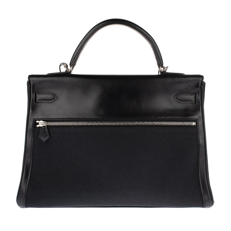 Stunning and rare ( Sold out, no longer produced by Hermès) Hermes Kelly Lakis handbag 35 cm in black leather and canvas H , palladium metal trim, simple handle in black leather , a removable leather and black canvas shoulder strap (not signed