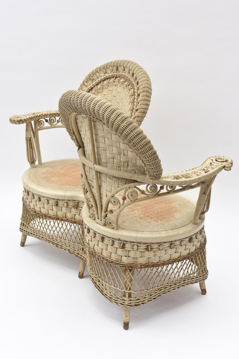 American Rare Heywood Brothers and Wakefield Victorian Wicker Conversation Gossip Chair For Sale