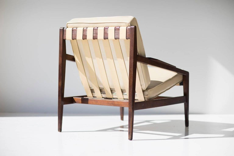 Designer: Ib Kofod-Larsen.  Manufacturer: Selig Imports. Period/Model: Mid-Century Modern. Specs: Wood, leather.   Condition:  This rare Ib Kofod Larsen lounge chair for Selig is in original vintage condition. Its original finish shows
