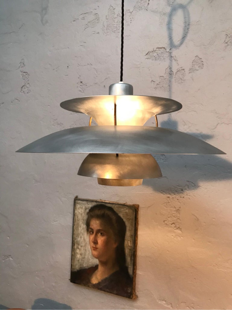Rare iconic vintage PH 5 chandelier pendant lamp from 1959. Poul Henningsen designed this iconic lamp in 1958. The production was started in 1959. During the first year of production they changed the design frequently. This is a one year only