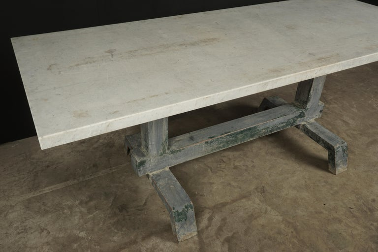 Rare industrial dining table from France, 1940s. Solid, thick marble top with fantastic patina on a steel base. Nice original color on base.