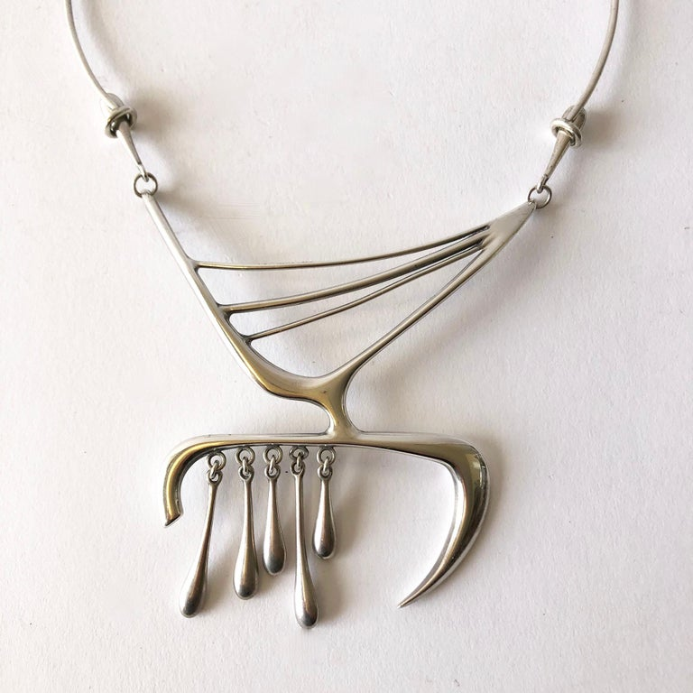 Important sterling silver abstract American modernist necklace created by sculptors and jewelers, Irvin and Bonnie Burkee.  Necklace is comprised of hand forged, webbed sterling silver and a highly inventive fastening mechanism on both sides of the
