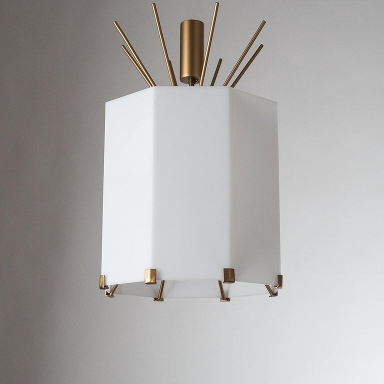 Rare Italian ceiling lights from the 1950s. Probably a custom design and production, these have large octagonal acrylic shades which are supported by a sputnik structure made of brass-powdered steel. When mounted to the ceiling the top stems will
