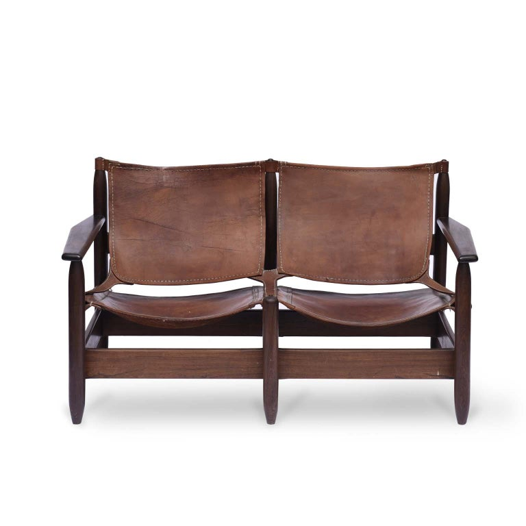 Rare Midcentury Brazilian bench/sofa in rosewood and leather, 1960s  This unique model available in our collection, this beautiful bench with solid rosewood structure has two seats in natural leather, where they were carefully sewn with thread.
