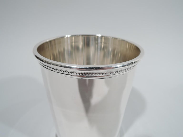 Kennedy-era sterling silver mint julep. Retailed by Scearce in Kentucy, 1961-1963. Traditional form with tapering sides and beading at rim and foot. Not many of these were made during the 35th president's incomplete single term. Fully marked