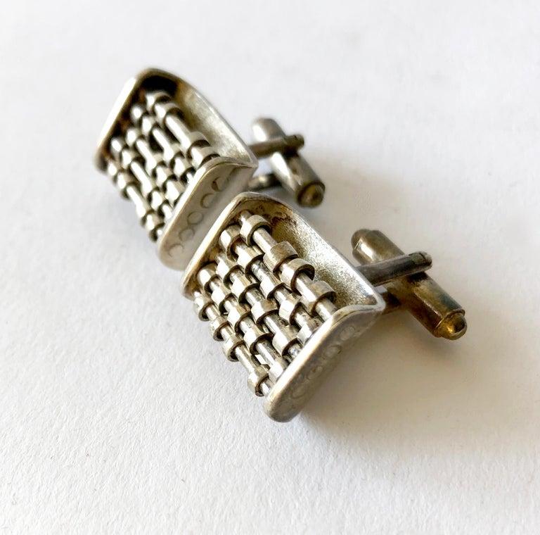 Rare pair of John Syzmak sterling silver abacus cufflinks, circa 1950's.  Cufflinks measure 5/8