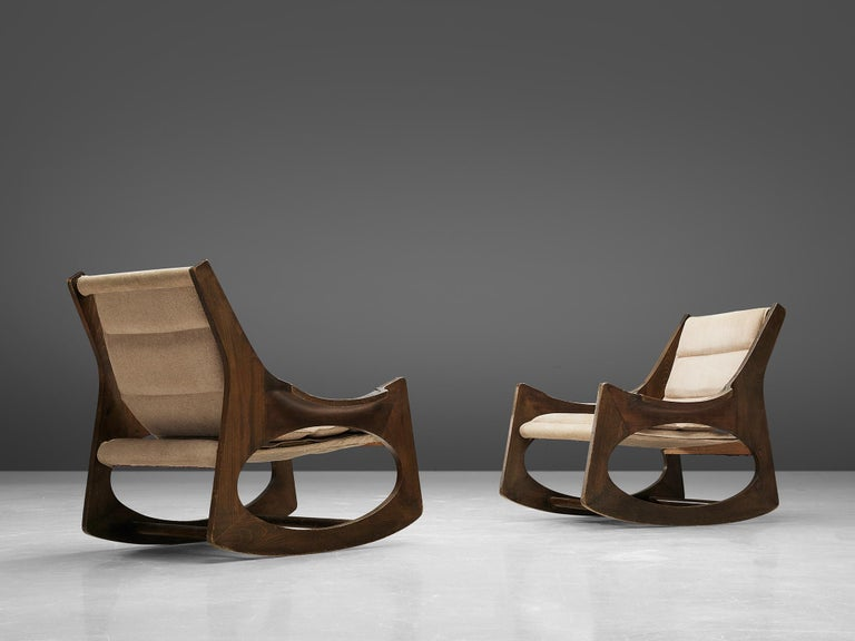 Jordi Vilanova i Bosch,' Tartera' rocking chairs, boxwood, beech, and fabric, Spain, design 1961, manufacture 1960s.  These two wonderful rocking chairs are made with two symmetrical side pieces, which integrate the structure of the backrest, arms,