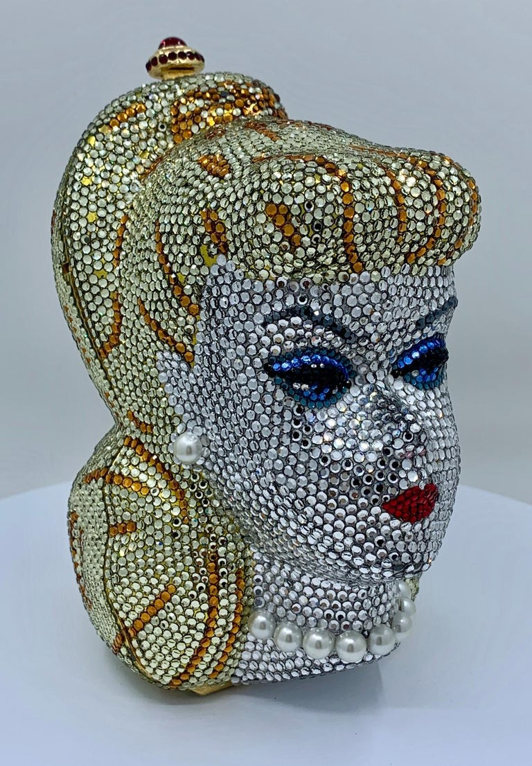 A rare, limited-edition, artist proof, signed and numbered, Swarovski crystal encrusted, gold-plated metal Barbie head shaped minaudière evening bag purse by celebrated handbag maker to the stars, Kathrine Baumann. This evening bag is numbered on a
