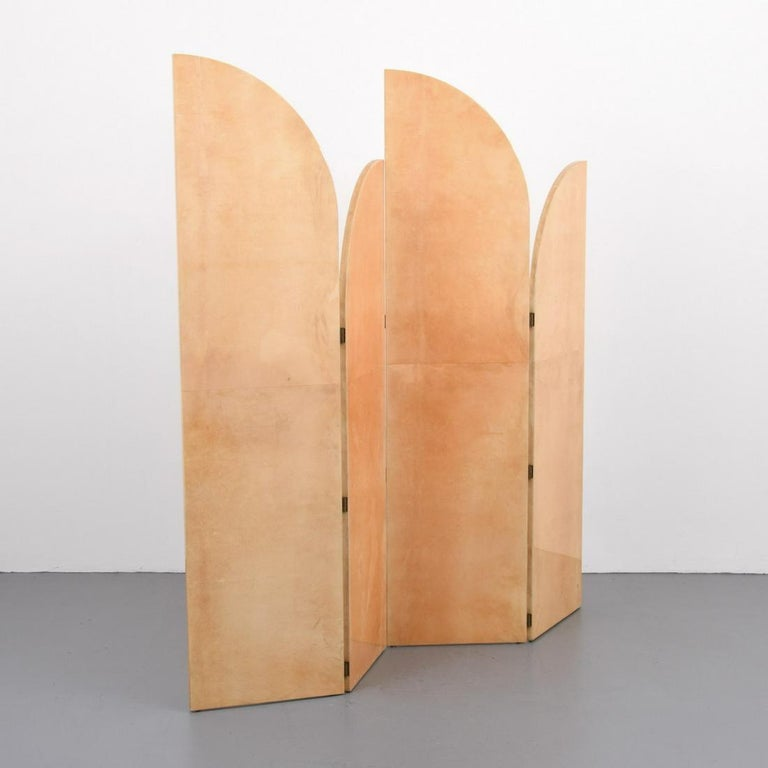Rare Art Deco style lacquered four fold parchment screen by Aldo Tura. This screen is very much in the Art Deco style, its design is very much inspired by the work of Jean Michel Frank.