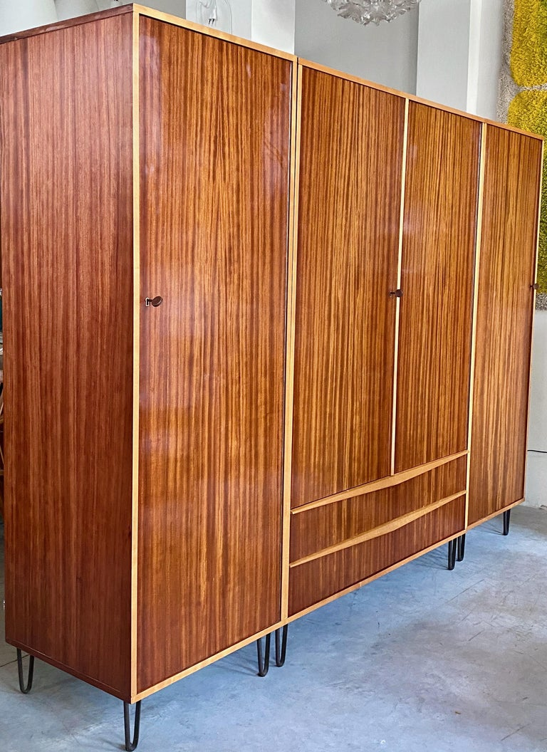 Original 1950s lined wardrobe designed by the Belgian designer Alfred Hendrickx for Belform from 1958. This closet features four doors with detailed three bronze keys. On the left side and right side, a compartment coat hanger. In the middle part of