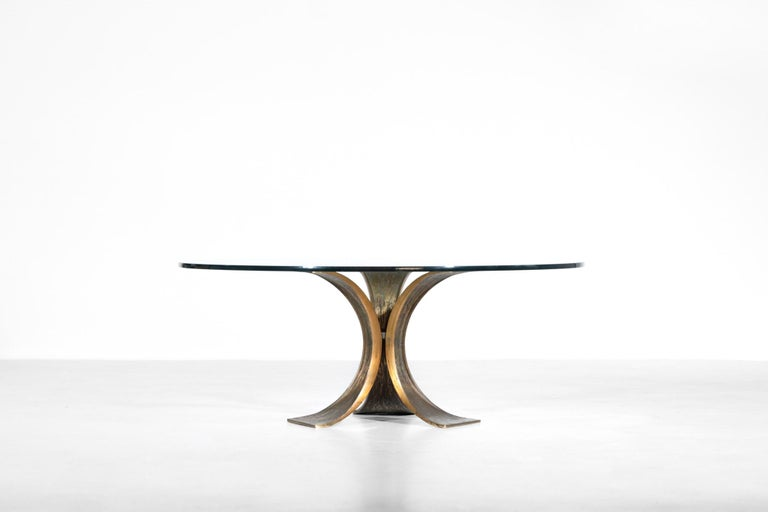 Large coffee table composed of bronze structure with round glass on the top. Really nice manufacture and design.