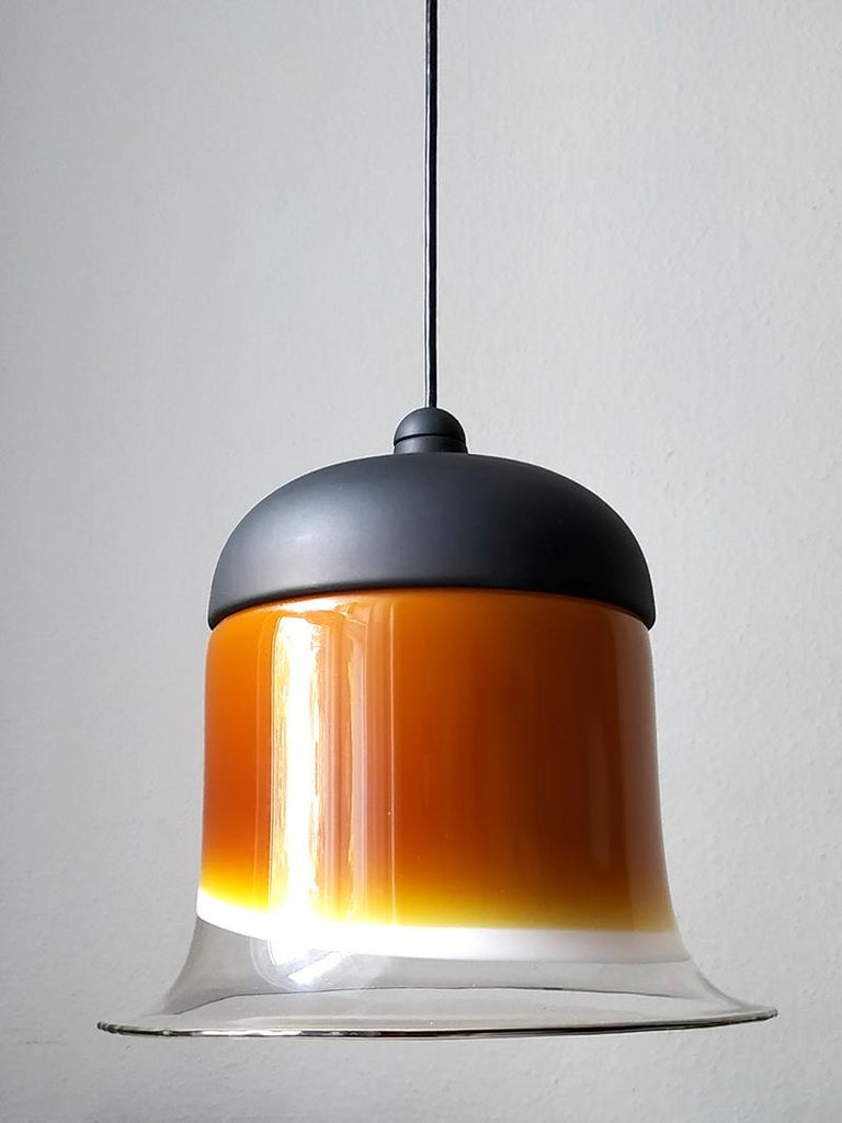 Wonderful hand blown multi-color glass and black lacquered metal pendant.