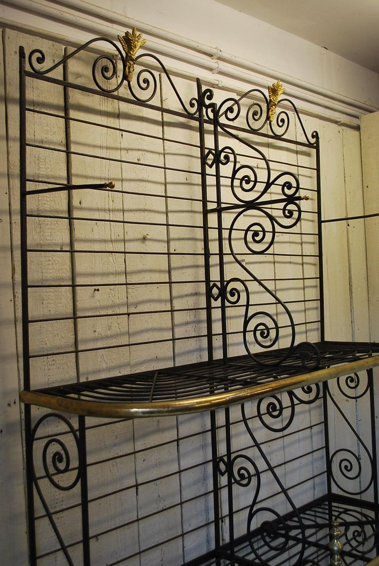 A very rare and unusual French antique shop display bakers Stand. Made in metal with fancy shaped sides and brass edging and embellished with wheatsheaf motifs.   Ideal in a house or commercial premises. The six shelves drop into place. These are