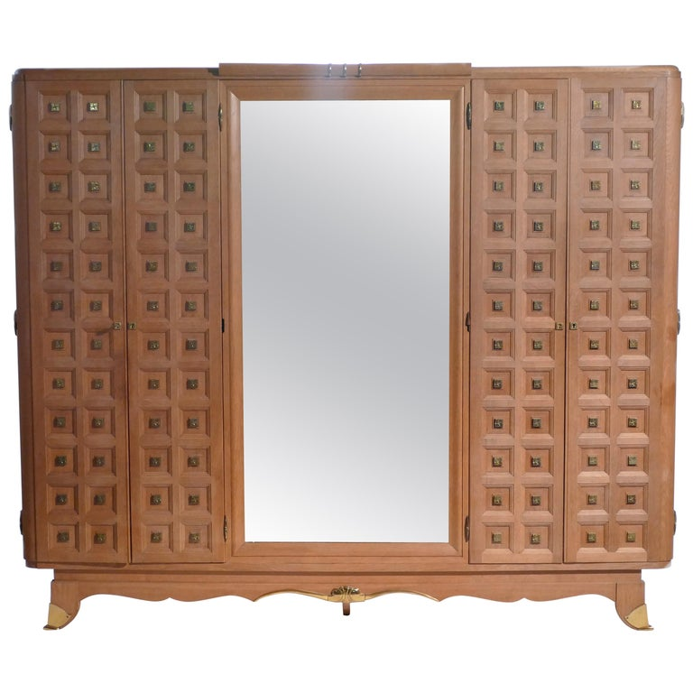 Spacious shelves and large mirror make this large oak wardrobe suitable as a bedroom armoire, or as a multipurpose and decorative cabinet in an entryway or living room. The cabin doors and feet are adorned with quality brass, and the inner shelves