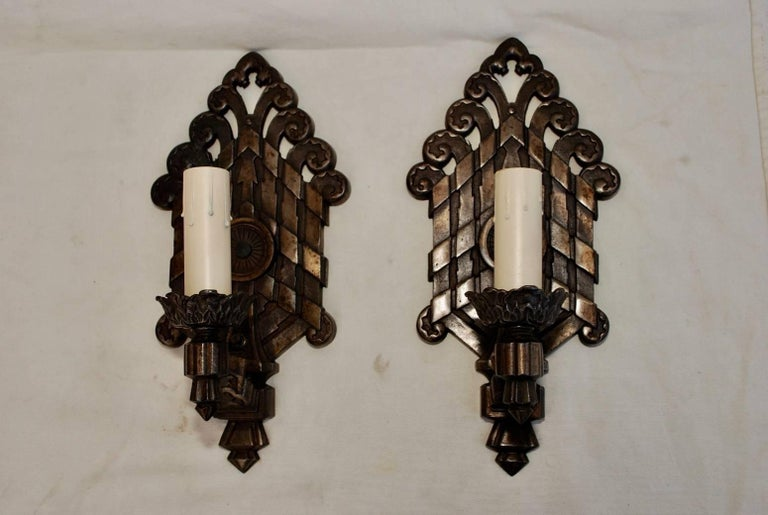 A rare pair of large 1920s cast iron sconces, they have been restored, they are quite heavy.