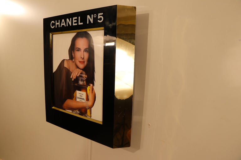 Wonderful back-lit original wall-mounted Chanel advertisement display formerly used in the perfume stores at the business jet-only airport