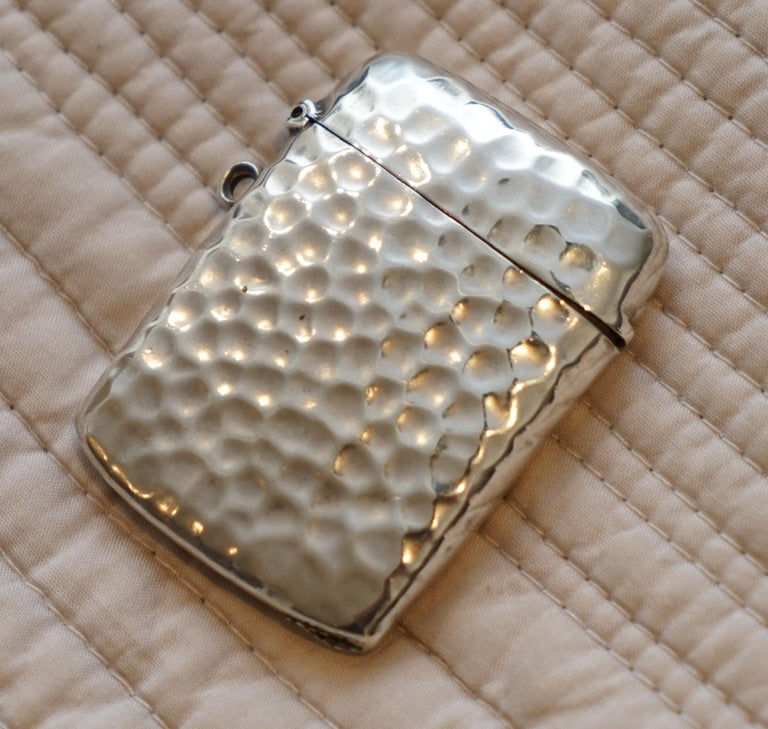 We are delighted to offer for sale this stunning very rare Liberty London 1899 hand hammered solid sterling vesta case made by William Hair Haseler  A very good looking decorative piece, its hand-hammered hence the lovely tactile finish, it opens